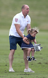 Mike Tindall with his daughter Mia, as they attend the Maserati Royal Charity Polo Trophy at Beauford Polo Club, Down Farm House, Westonbirt, Gloucestershire.<br />