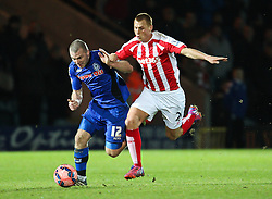 Rochdale's Stephen Dawson is fouled by Stoke City's Steve Sidwell - Photo mandatory by-line: Matt McNulty/JMP - Mobile: 07966 386802 - 26/01/2015 - SPORT - Football - Rochdale - Spotland Stadium - Rochdale v Stoke City - FA Cup Fourth Round