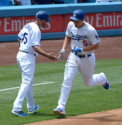 June 7, 2017 - Los Angeles, California, U.S. - Los Angeles Dodgers' Corey Seager (5) rounds third base and shake hands with third base coach Chris Woodward (45) after hitting a solo home run in the sixth inning of a Major League baseball game against the Washington Nationals at Dodger Stadium on Wednesday, June 7, 2017 in Los Angeles. Los Angeles Dodgers won 2-1. (Photo by Keith Birmingham, Pasadena Star-News/SCNG) (Credit Image: © San Gabriel Valley Tribune via ZUMA Wire)