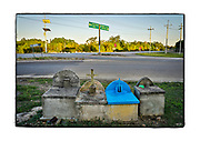 """SHOT 2/17/19 5:34:28 PM - A set of four capillas at the intersection of two highways on the outskirts of Akil, Yucatan Mexico. The capillas are often dedicated to certain patron saints or in this case someone that has died at or near the site. Often times they contain prayer candles, pictures, personal artifacts or notes. Akil Municipality (Yucatec Maya: """"place of the vines"""") is one of the 106 municipalities in the Mexican state of Yucatan containing (48.54 km2) of land and is located roughly 100 kilometres (62 mi) southeast of the city of Merida.<br /> (Photo by Marc Piscotty / © 2019)"""