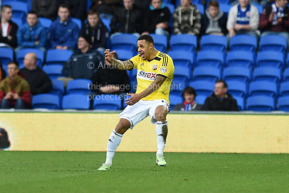Andre Gray of Brentford celebrates after he scores his teams 2nd goal. Skybet football league championship match, Cardiff city v Brentford at the Cardiff city stadium in Cardiff, South Wales on Saturday 20th December 2014<br /> pic by Andrew Orchard, Andrew Orchard sports photography.