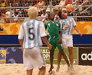 Football-FIFA Beach Soccer World Cup 2006 - Group D-ARG_NGA - Santiago Lopez jump to head the ball withGabriel Agu-NGA.- Rio de Janeiro - Brazil 02/11/2006<br />Mandatory credit: FIFA/ Marco Antonio Rezende.