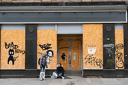 Glasgow, Scotland, UK. 6 Mar 2021. With Scotland remaining under national lockdown during the covid-19 pandemic Glasgow city centre remains a virtual ghost town with few people in the city centre and almost all shops and businesses still closed.  Pic; Homeless people outside closed and boarded up business. Iain Masterton/Alamy Live News