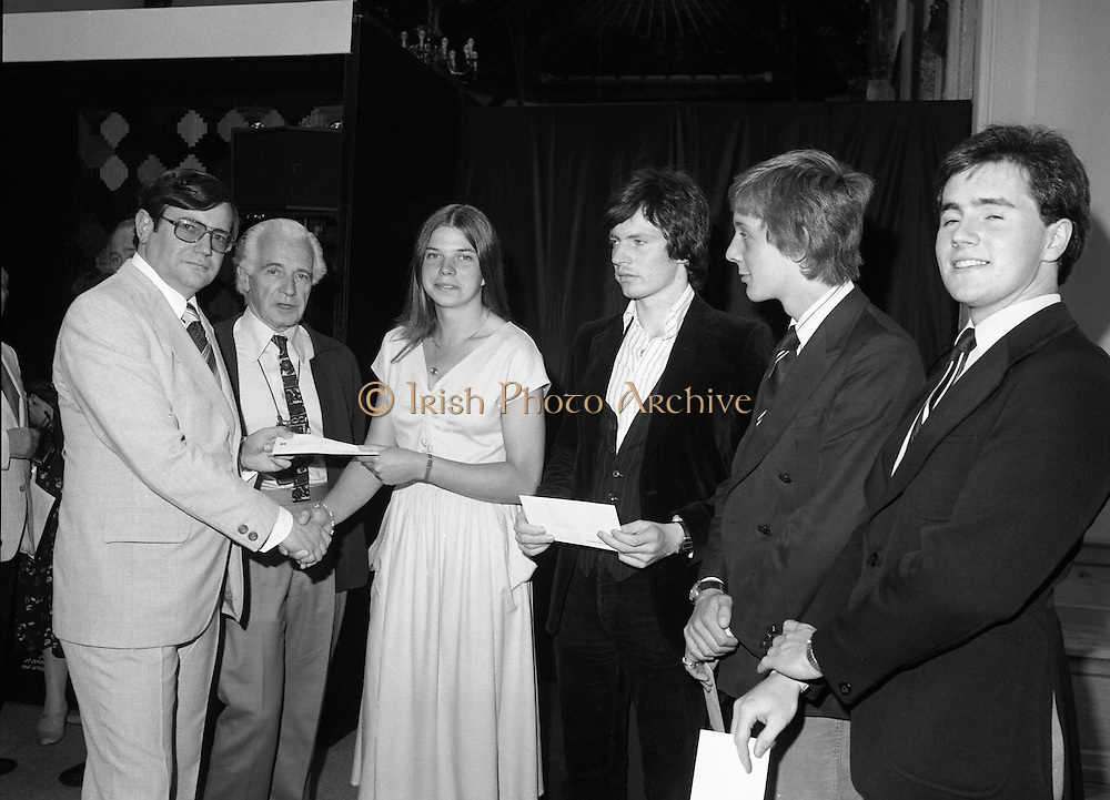 09/08/1979.08/09/1979.9th August 1979.Opening of Irish Patchwork exhibition and Presentation of the Young Designer Awards at Kilkenny Castle. Ray Burke, T.D. presents the winners of the young designer awards  with their prizes. From L-R Ray Burke, Minister of State at the Department of Ind., Comm. and Energy, Miss Catherine MacAleavey, Cabinteely , Co. Dublin, Stephen Lennon, Palmerston, Dublin, Declan O'Donoghue, Monkstown, Cork and Bryan Leech, Enniscorthy, Co.Wexford. Sir Basil Goulding, Chairman, Chairman of Kilkenny Design Workshops is 2nd left.