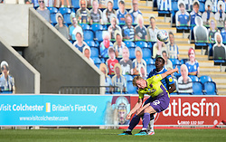 Kwame Poku of Colchester United and Jack Sparkes of Exeter City tussle for the ball infront of the cardboard cut out fans - Mandatory by-line: Arron Gent/JMP - 18/06/2020 - FOOTBALL - JobServe Community Stadium - Colchester, England - Colchester United v Exeter City - Sky Bet League Two Play-off 1st Leg