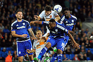 Hull City's Alex Bruce (white shirt) clears from Cardiff City's Bruno Ecuele Manga and Kagisho Dikgacoi. Skybet football league championship match, Cardiff city v Hull city at the Cardiff city stadium in Cardiff, South Wales on Tuesday 15th Sept 2015.<br /> pic by Carl Robertson, Andrew Orchard sports photography.