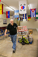 LITTLE ROCK, AR: DECEMBER 10, 2013<br /> Mark Riley volunteering at the Mosaic Church in Little Rock, Arkansas helping to put out food.<br /> CREDIT: Wesley Hitt for The Wall Street Journal<br /> MENJOBS