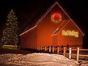 Winter view of historic red barn built in the early 1880s to service ore wagons, Sun Valley, Idaho.