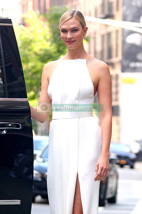 Karlie Kloss wears a White square neck gown with black heels as she holds hands with Designer Jason Wu, As they head to the CFDA awards, NYC. 04 Jun 2018 Pictured: Karlie Kloss and Jason Wu. Photo credit: MEGA TheMegaAgency.com +1 888 505 6342