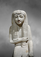 """Ancient Egyptian statue of Hel, limestone, New Kingdom, late 18th Dynasty, (1320-1280 BC), Saqqara. Egyptian Museum, Turin. Grey background.<br /> <br /> The women is seated on a cushioned stool. On her head is a lotus flower. In her left hand she holds a cloth in her right a counterweight for a meant necklace, a ritual instrument used in the cult of the goddess Hathor. the statue probably stood in a tomb in Saqqara necropolis of Memphis, where the Egyptian eletes of the time had splendid tombs with statues of s similar style. The inscription evokes the deceased """"everything that comes forth in the presence of the gods of Memphis for Osiris, the lady of Hel..."""" .<br /> <br /> If you prefer to buy from our ALAMY PHOTO LIBRARY  Collection visit : https://www.alamy.com/portfolio/paul-williams-funkystock/ancient-egyptian-art-artefacts.html  . Type -   Turin   - into the LOWER SEARCH WITHIN GALLERY box. Refine search by adding background colour, subject etc<br /> <br /> Visit our ANCIENT WORLD PHOTO COLLECTIONS for more photos to download or buy as wall art prints https://funkystock.photoshelter.com/gallery-collection/Ancient-World-Art-Antiquities-Historic-Sites-Pictures-Images-of/C00006u26yqSkDOM"""