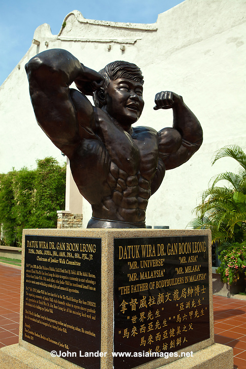 Statue of a locally prominent politician Datuk Wira Gan Boon Leong. He was once possessed the title of 'Mr. Universe', 'Mr. Asia' and 'Mr. Malaysia' in body building. This statue is located just in front of his body building academy in Malacca Chinatown.