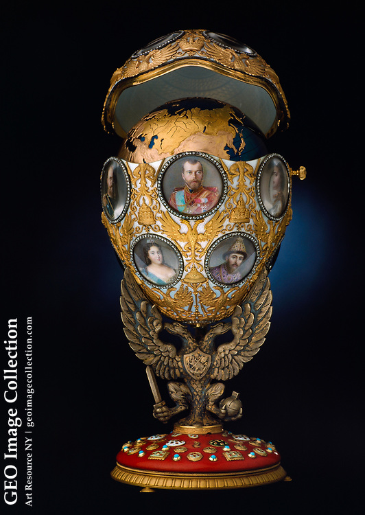 Romanov Tercentenary egg, an Imperial Fabergé egg with portraits of Czar Nicholas II and his family made to celebrate 300 years of Romanov Dynasty. The Romanov Tercentenary egg is a jewelled Easter egg made under the supervision of the Russian jeweller Peter Carl Fabergé in 1913, for Tsar Nicholas II of Russia. The Fabergé egg was presented by Nicolas II as an Easter gift to his wife, the Tsaritsa Alexandra Fyodorovna. Peter Carl Faberge inherited his father's jewelry business in St. Petersburg and began making objects of fantasy. In 1884, Alexander III commissioned the first Easter egg for his tsarina. Until Faberge was exiled in 1917, two eggs per year were made as gifts for the wives and mothers of Alexander III and Nicholas II. The eggs were actually made by master craftsmen Pirkhin or Vikstrem from Faberge's workshop. Portraits include all of Nicholas' children, and all Romanovs.  Gift to Nicholas' wife, Alexandra. Height 7 5/10 inches, 18.5 cm, 185mm.