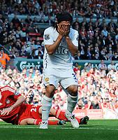 An Unhappy Carlos Tevez <br /> Manchester United 2008/09<br /> Liverpool V Manchester United (2-1) 13/09/08<br /> The Barclays Premier League<br /> Photo Robin Parker Fotosports International