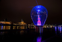 """LYON, FRANCE - DECEMBER 04: For four nights over 70 light installations will create a magical atmosphere in the streets, squares and parks all over the city and millions of visitors both French and from abroad will enjoy the friendly and joyful spirit of this unique event on December 4, 2014 in Lyon, France. (Photo by Bruno Vigneron/Getty Images)Incandescence<br /> Terrasses de la Guillotière , Lyon 3<br /> Artist: Séverine Fontaine<br /> Incandescent lightbulbs like the ones that bathed us for many years in their warm glow are back in an outsize format! Like a living, vibrating body, a giant replica of the universal """"A cap base E27"""" bulb comes to life, unscrews from its base and pulls other bulbs along after it. With their filaments and various shapes, these other bulbs reveal the diversity of our lighting.<br /> With the technical support of Philips and Seet Europole.<br /> Opening hoursFriday 5th and Saturday 6th: from 6 p.m to 1 a.mSunday 7th: from 5:30 p.m to midnightMonday 8th: from 6 p.m to midnight<br /> Metro Line D or T1 Tramway - Guillotière stop"""