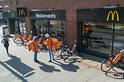 As Londoners increasingly turn to takeaway deliveries supplied by the casual riders of the gig economy, eBikes are lined up outside the McDonalds on the Walworth Road, during the third lockdown of the Coronavirus pandemic, on 29th March 2021, in London, England.