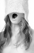 Woman with hat pulled over her eyes, mouth open