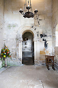 Interior stone arch leading to altar inside Saxon church of Saint Laurence, Bradford on Avon, Wiltshire, England, UK probably built circa 1000 AD
