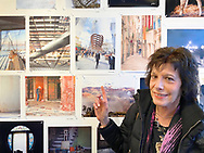 "Huntington, New York, U.S. February 29, 2020.  SUSAN K. SILKOWITZ points to her photo during fotofoto gallery reception for its ""Your Best Shot"" Open Photography push-pin exhibition."