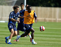 Photo: Daniel Hambury.<br />Chelsea Training Session. The Barclays Premiership. 24/07/2006.<br />Michael Essien gets to grips with acadamy player Jimmy Smith during training.