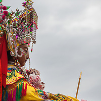The Mazu icon from the original Mazu temple on Meizhou Island. <br /> <br /> Sailors and fisherman say that they would see Mazu as a woman dressed in red or a glowing presence guiding them to safety during storms. At multiple coastal locations, huge statues of her tower over the sea.