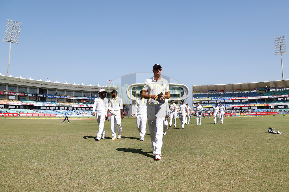 England Players walks back to the pavilion for lunch during day 3 of the first test match between India and England held at the Saurashtra Cricket Association Stadium , Rajkot on the 11th November 2016.<br /> <br /> Photo by: Deepak Malik/ BCCI/ SPORTZPICS