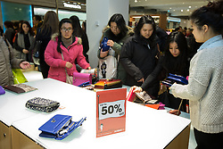 © Licensed to London News Pictures . 26/12/2013 . Manchester , UK . Reduced handbags are cleared from displays in Selfridges within minutes of the store opening . Queues for Selfridges in Manchester , ahead of an 8am opening . Thousands of shoppers queue for hours in freezing temperatures in Manchester this Boxing Day morning (26th December 2013) in order to be amongst the first to purchase reduced price products in shops' sales . Photo credit : Joel Goodman/LNP