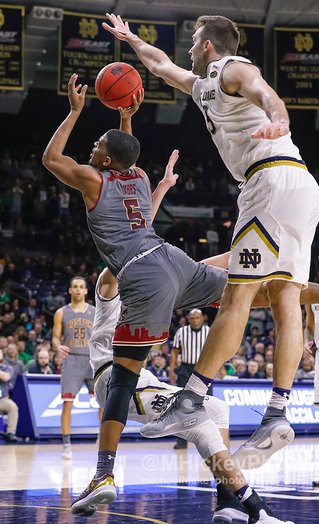 SOUTH BEND, IN - JANUARY 12: Wynston Tabbs #5 of the Boston College Eagles shoots the ball as Dane Goodwin #23 of the Notre Dame Fighting Irish reaches for the block during the game at Purcell Pavilion on January 12, 2019 in South Bend, Indiana. (Photo by Michael Hickey/Getty Images) *** Local Caption *** Wynston Tabbs