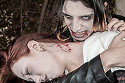 A young couple in their 20s dressed up as Vampires Model release available