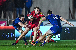Scarlets' Ioan Nicholas evades the tackle of Leinster's Jack Conan and Adam Coyle<br /> <br /> Photographer Craig Thomas/Replay Images<br /> <br /> Guinness PRO14 Round 17 - Scarlets v Leinster - Friday 9th March 2018 - Parc Y Scarlets - Llanelli<br /> <br /> World Copyright © Replay Images . All rights reserved. info@replayimages.co.uk - http://replayimages.co.uk