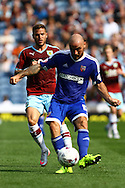 Alan McCormack of Brentford passes the ball back. Skybet football league championship match, Burnley  v Brentford at Turf Moor in Burnley, Lancs on Saturday 22nd August 2015.<br /> pic by Chris Stading, Andrew Orchard sports photography.