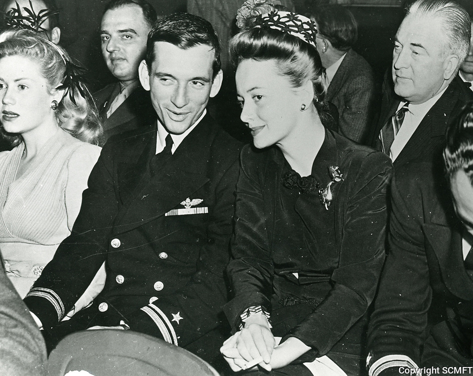 10/3/42 Actress, Olivia de Havilland sits in the bleachers during the Hollywood Canteen's opening ceremony.