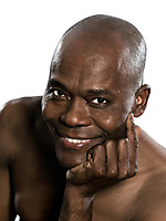 afro American smiling man topless portrait in studio on white isolated background