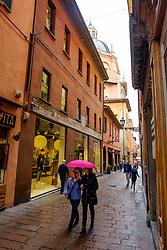 People walking in the rain in a side street near the Piazza Maggiore, Bologna, Italy<br /> <br /> (c) Andrew Wilson | Edinburgh Elite media