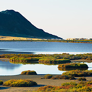 The Las Salinas de Cabo de Gata near the town of Cabo de Gata, Spain. It is a wetland, special protection area, and Ramsar site which provides an important habitat for both the resident birds and the thousands of migrating birds that stop on their journey between Europe and Africa.  Flamingos, herons, storks and cranes can be seen here.