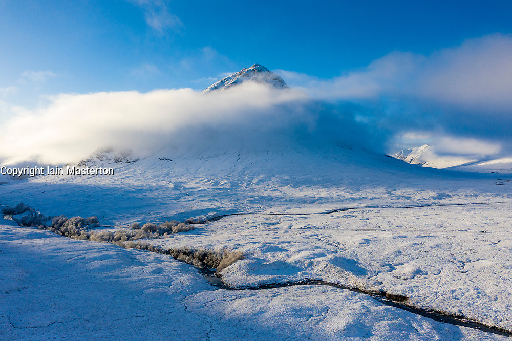 Glen Coe, Scotland, UK. 3 December 2020. A cold front has brought the first snowfall to the Scottish Highlands. Rannoch Moor and Glen Coe are covered in several inches of snow. Bright sunshine throughout the day created beautiful winter landscapes.  Pictured; Buachaille Etive Mor  shrouded in mist.  Iain Masterton/Alamy Live News