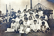 large group of women with children posing at a theme park 1920s