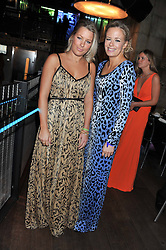 Left to right, sisters DAVINA HARBORD and ASTRID HARBORD at the Wild for WSPA dinner in aid of the charity World Society for the Protection of Animals held at Under The Bridge, Stamford Bridge, Fulham Road, London on 23rd February 2012.