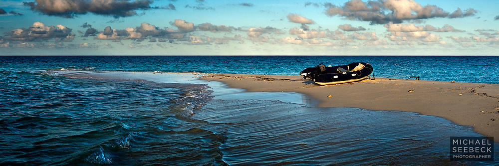 A zodiac rests on a sand cay of the Great Barrier Reef, late in the afternoon...<br /> <br /> Open Edition Print