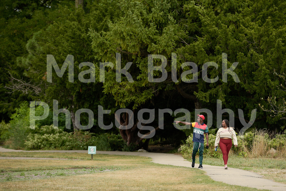 A couple walk in Lincoln Park in Chicago on Thursday, Sept. 3, 2020. Photo by Mark Black