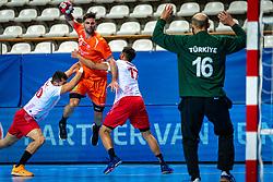 The Dutch handball player Jorn Smits, Gorkem Bicer in action during the European Championship qualifying match against Turkey in the Topsport Center Almere.