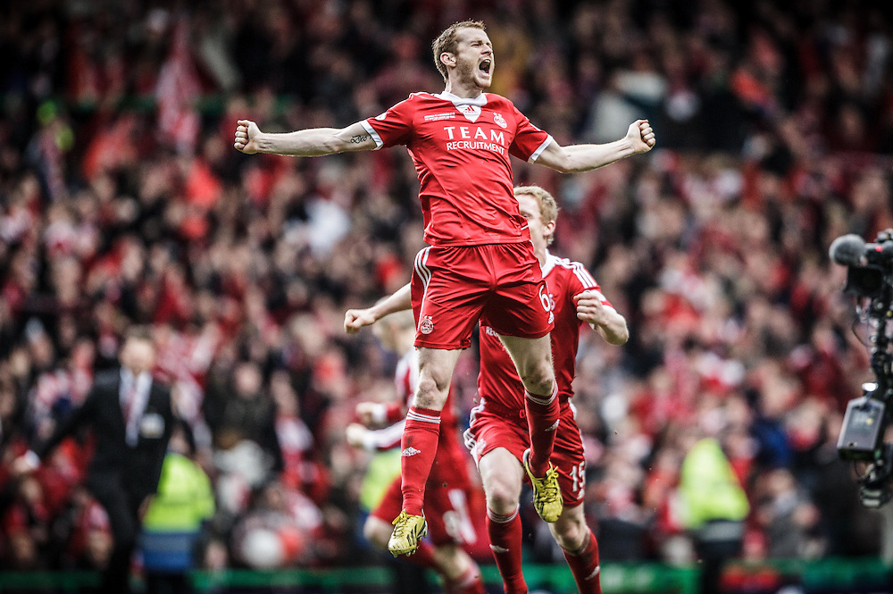 Scottish League Cup Final Aberdeen V Inverness CT at Parkhead on Sunday, 16th of March 2014, Aberdeen Scotland.<br /> Pictured: Mark Reynolds, Aberdeen win the Scottish League Cup after penalties<br /> (Photo Ross Johnston/Newsline Scotland)