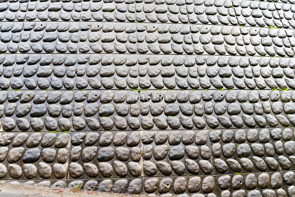 artificial stone in concrete motive landslide wall protection Kyoto Japan