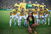 London, UK. Thursday 12th June 2014. Posing for a photograph by the Brazil team. Brazilians gather for the Brazil Day celebrations in Trafalgar Sq. A gathering to celebrate the beginning of the Brazil 2014 FIFA World Cup. Revellers sing and dance and play football games and all in the yellow green and blue of the Brazilian flag.
