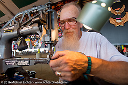 Jim Beaux Shockley works the sewing machine in his vendor booth at the 2016 ROT (Republic of Texas Rally). Austin, TX, USA. Friday, June 10, 2016.  Photography ©2016 Michael Lichter.