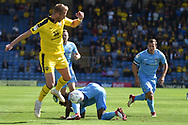 Oxford United midfielder James Henry (17)  rides a tackle during the EFL Sky Bet League 1 match between Oxford United and Coventry City at the Kassam Stadium, Oxford, England on 9 September 2018.