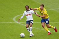 Daniel Johnson of Preston North End and Gary Gardner of Birmingham City