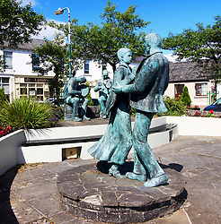August 6, 2017 - Lisdoonvarna, IRL - Lisdoonvarna's market square features bronze statues of a fiddler and bodhran player performing for dancers about to take their first tentative step in a waltz. It's a fitting nod to the town's melodious matchmaking heritage. (Credit Image: © Vic O'Sullivan/TNS via ZUMA Wire)