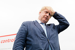 © Licensed to London News Pictures. 04/06/2016. LONDON, UK.  BORIS JOHNSON waiting to speak at a Vote Leave rally at Forman's Fish Island in east London. Vote Leave is the official campaign for a Leave vote (Brexit) in the EU Referendum that will take place in the United Kingdom on the 23rd June 2016.  Photo credit: Vickie Flores/LNP
