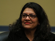 Rep. Rashida Tlaib (D-MI) listens at a Congressional hearing examining lessons from the civil rights movement on combating efforts to suppress the right to vote and how many of these lessons are particularly urgent in the face of similar voter suppression efforts today.