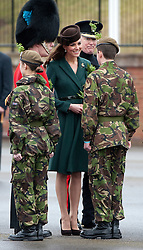© London News Pictures. 17/03/2012. Aldershot, UK. The Duchess of Cambride CATHERINE (KATE) MIDDLETON taking to Mini Micks cadets after presenting traditional sprigs of shamrock to the 1st Battalion Irish Guards at Mons Barracks in Aldershot, Hampshire, UK,  on Saint Patrick's Day, March 17th, 2012.  Photo credit : Ben Cawthra/LNP.